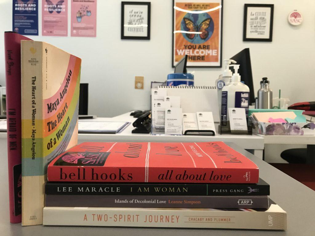 feminist books in a pile