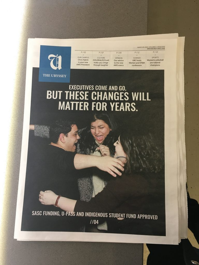 Ubyssey newspaper front page shows three people smiling and hugging and reads These Changes Will Matter For Years